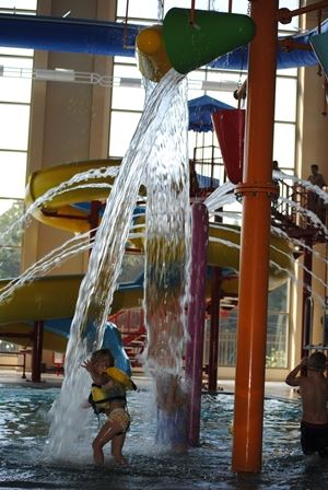 Children playing and having fun in the leisure pool area.