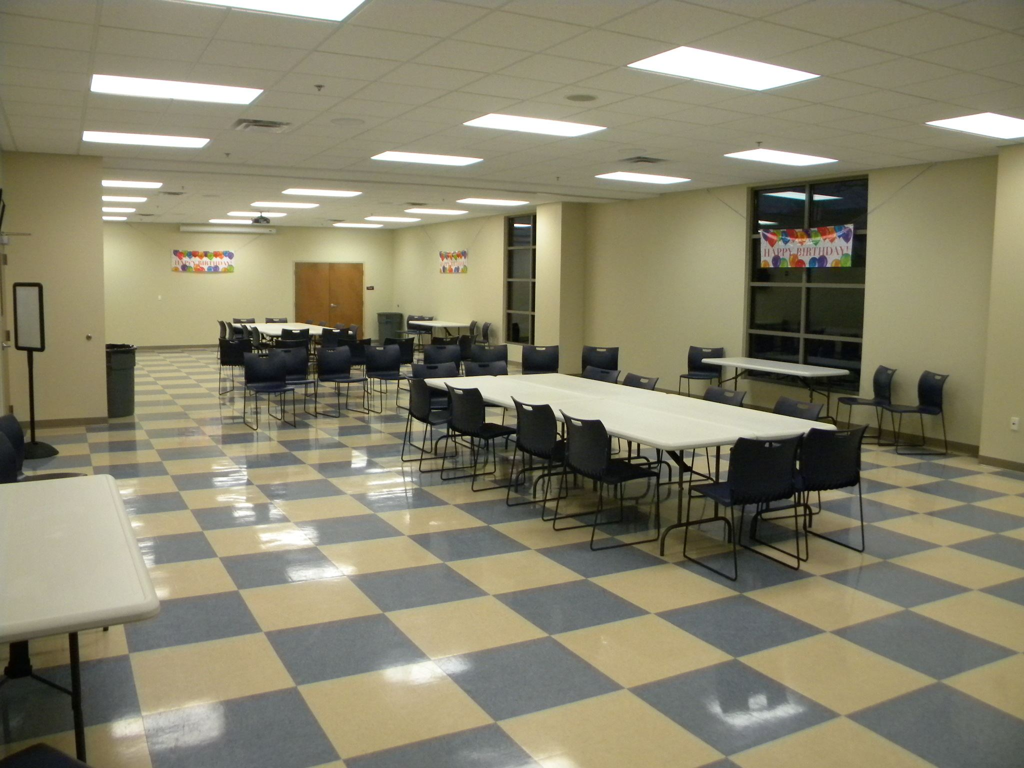A large room set up with tables and chairs.